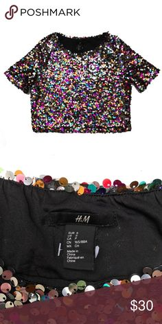 """Multicolored Sequin Crop Top Super cute! Super fun! Festival, Special Event, Holiday Wear, Club Wear, or everyday wear if you're really funky! 18"""" Length. 9"""" Sleeves. Sequins are Gold, Silver, Green, Blue, Fuchsia and Teal on a Black mesh underlay and lined. NWOT Condition. H&M Tops Crop Tops"""