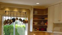 See how a Vestabul designer adds Mediterranean style to evoke travel memories every time these homeowners entered their kitchen! Mediterranean Style, Valance Curtains, Ceiling Lights, Display, Storage, Kitchen, Design, Home Decor, Floor Space