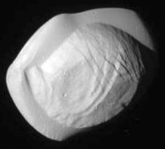 Pan, a moon of Saturn, is 34.4 × 31.4 × 20.8 km.