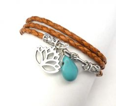 $37.00  This leather wrap bracelet features a pewter Lotus flower charm and a turquoise teardrop bead bead hang from the S clasp of orange braided leather. http://www.charmeddesign.com/product/leather-wrap-bracelet-lotus-and-turquoise #leather #handmade #lotus