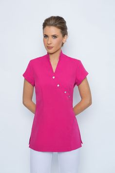 SPA 10 Diamonte Tunic. Cap sleeve, mandarin collar. Zips at rear. Flattering and very comfortable Removable diamonte buttons ( zips at the rear so the buttons are purely for decoration and can be removed by you after the sale if you wish-we do not remove the buttons prior to sale) Available in Black, white, Hot Pink, Dove Grey, Charcoal Grey and Electric Blue ( white fabric is a heavier weight and not see through) Made from corporate grade easy wash and wear stretch fabric Standard…