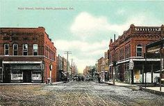 Jonesboro Arkansas AR 1908 Town Main Street North Antique Vintage Postcards Jonesboro Arkansas AR Circa 1908 Downtown on Main Street North with T. J. Ellis Jewelry Store in left foreground with a boy