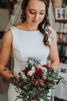 flowers winter wedding august new zealand red burgundy navy berries bouquet greenery roses