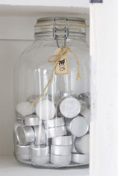 Glass preserve jar storage for tea light candles >> would look lovely in the laundry room!!!