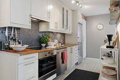 White Kitchen Interior with Wooden Countertop