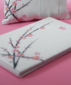 This artistic Cherry Blossom Wedding Guest Book features refined white linen fabric skillfully silk-screened with delicate branches of cherry blossom.