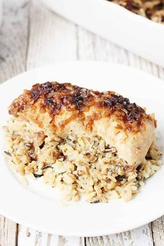 "One-pan ""no peek"" chicken and rice is sure to become a favorite family meal! Wild rice, soup, and chicken are combined in a single baking dish then baked to creamy chicken and rice perfection! No Peek Chicken, One Pan Chicken, Simple Chicken Dishes, Raw Chicken, Cheesy Chicken, Grilled Chicken, One Pan Meals, Easy Meals, One Pan Dinner Recipes"