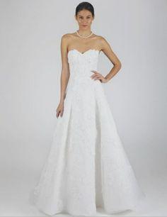 Oscar de la Renta style 44E63. Oscar de la Renta gowns are sold at The Bridal Salon at Saks Jandel.