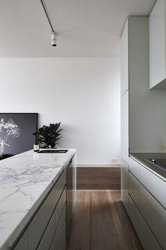 """White room."" Interior. Marble kitchen countertop."