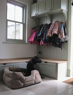 Love this boot room- each child has a pull out drawer for all their stuff.