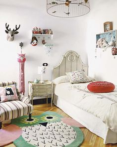 the boo and the boy: eclectic kids' rooms ....love the ceiling wire bird light and headboard endtable and chair