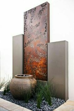 Outdoor art, landscaping, privacy screen, rock, metal, pottery