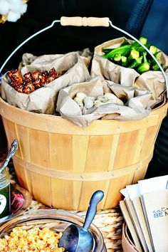 a great way to display snacks for tailgating.  Place paper sacks in apple baskets and fill with favorite munchies! via At The Picket Fence and @HGTVGardens