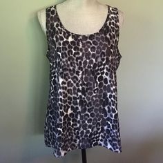 Stylish Express top Beautiful black and white print light weight sleeveless top. Perfect condition. Never worn Express Tops Tank Tops