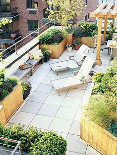 Gestaltungsideen Dachterrasse Pflanzen und Möbel