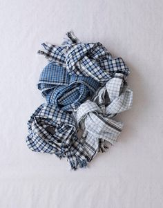Gamcha (India), a multipurpose checked cotton cloth commonly used by men throughout India as a towel, scarf, head dress, lunghi, or draped over the shoulder.