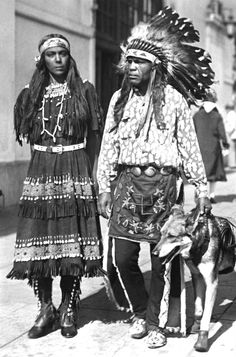 """Couple to ride horses across continent: Rainbow Sistesso, a Sioux woman and Little Chief White Eagle, a Yaqui Native American plan to try for a new style of record, riding horseback from Los Angeles to New York in Indian style, using the same horses all the way. It will be a honeymoon trip, they said yesterday, for White Eagle has 'found the Rainbow' and the wedding is set for the near future. The trip will be started in the spring, when weather is better."""" Photo: October, 1930."""