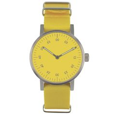 Det var på tiden! Basic är VOID Watches tredje produktserie och är en stilren, minimalistisk klocka med en boett i rostfritt stål. Det välvda glaset är gjort i mineralkristall för extra hållighet och fulländar denna design. Boett: Rostfritt stål. Armband: Gul nylon. Ø 38mm.