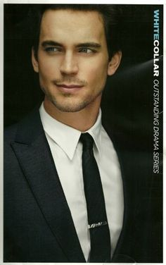 Matt Bomer in a dashing suit and spotless point collar custom dress shirt