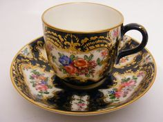 Worcester coffee cup and saucer hand painted by Walter Sedgley  1923-1925
