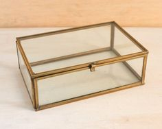 6 long x 4 wide x 2 1/8 high.    This is a vintage glass and brass trinket box. The sides and top are brass edged glass with brass hinges