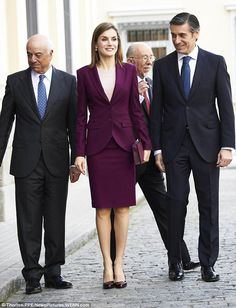 Reaching for an old favourite: Queen Letizia, 43, arrives at the Microfinanzas BBVA Foundation headquarters in Madrid earlier today wearing a suit she's worn three times in a year