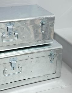 $151.00 These wonderful zinc suitcases can be opened with their lid but also at the front meaning that you can stack one on top of each other and still access things inside. These are sold as a set of 2 and also come with wheels so that (if you are willing to screw holes in the bottom of the cases) you can turn the large one into a handy side table.
