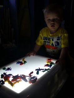 DIY light table for kids using large plastic storage bin. Could use for tracing