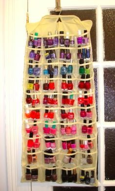 A hanging jewelry organizer is a great idea for keeping nail polishes organized. You can group them together by color and keep them in the pockets in whatever order you choose. You can also use a hanging shoe organizer and get the same result. They hang up on closet doors or the back of the bedroom or bathroom door so they stay out of the way and keep your polishes perfectly organized