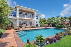 See this exquisite Kauai home for sale in Kalaheo. Beautiful ocean views are complemented by its immaculate presentation both inside and out. The exterior of this Kauai home is a haven with private pool and spa in a botanical paradise. Click photo for details.