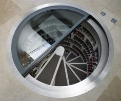 A spiral cellar is an ingenious way to house a wine collection, perfect for urban homes where space is often limited. The cellar can be installed in virtually Cave A Vin Design, Spiral Wine Cellar, Underground Cellar, Trap Door, Interior Architecture, Interior Design, Spiral Staircase, Staircases, Staircase Design