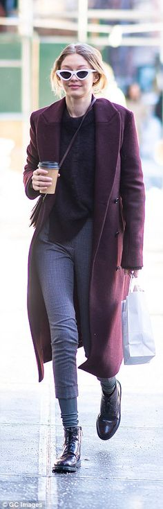 The fashionista paired her cosy look with a thick purple jumper and skinny tweed-style cro...
