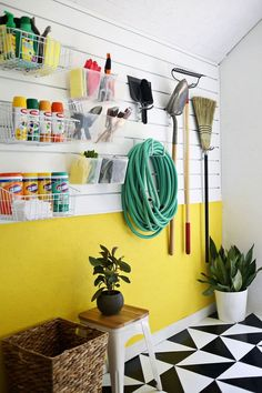 Add a pop of color and some style to your garage wall with some cheery paint and this simple panel system.