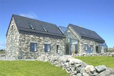 Two Stone Cottages Connected by a Glass Staircase A combination of countryside cottage architecture with a contemporary twist, this stone home designed by Peter Legge. Stone Cottages, Stone Houses, Rustic Style, Countryside, New Homes, House Design, Cabin, Contemporary, Mansions