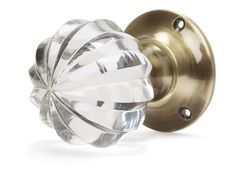 Vivien Pair of Brass Interior Door Knobs  These strikingly decorative fluted cut glass interior door knobs feature a brass metal base and are sold in pairs. www.furnitureanddesignla.snappages.com/home