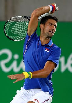 Novak Dokovic of Serbia plays a forehand against Juan Martin Del Potro of Argentina in their singles match on Day 2 of the Rio 2016 Olympic…