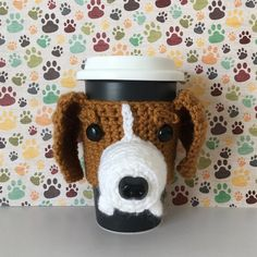 If you love to drink coffee and are the proud parent of a Beagle bring some of their appealing and soulful expression directly to your favorite mug! Simply slip this lifelike Beagle cozy on and be prepared to proudly smile every time you enjoy your favorite brew. This cozy is an original HookedbyAngel design. It is hand crocheted by me. I look at a photo of the dog and try to capture its uniqueness in yarn.
