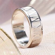 A beautiful wedding band for men. Roman numeral engraving across the band makes this ring truly unique and elegant. {Photo by Sorella Jewelry Studio}