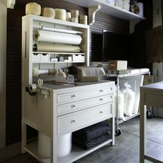 Packing station in Martha Stewart's homekeeping room. I so want a room like this with all my project materials organized and at the ready!