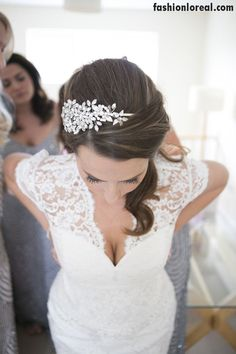 Love the style of this dress & hair piece! Image by By David Long Photography - A British Beachside Wedding At The Gallivant Hotel On Camber Sands With The Suzanne Neville Captivating Dress And Sequin Bridesmaid Dresses Photographed By David Long.