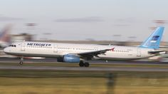 """The Metrojet Airbus A321 that crashed in Egypt's Sinai peninsula on Saturday is shown in this Oct. 20, 2015 photo taking off from Moscow's Domodedovo airport. Egypt and Russis have dismissed claims that a bomb brought down the aircraft but British Prime Minister David Cameron has said that it was """"more likely than not"""" that a bomb brought down the jetliner.."""