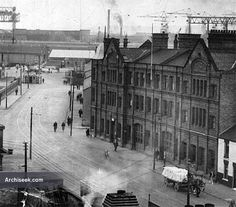 1895 - Whitla Street Fire Station, Belfast, Co. Antrim. Harland & Wolff shipyard can be seen in the background.