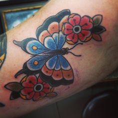 Traditional Tattoos. Butterfly tattoo by Nick Kelly. Signature Tattoo in Ferndale, MI.  #butterflytattoos #flowertattoos #nickkelly #signaturetattoo