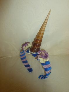 Unicorn headband, custom colours. £30.00, via Etsy.