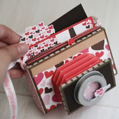 I stumbled across these mini albums in the shape of cameras and had to share! So unique and a perfect way to present a mini-album as a gift (say for example Mother's Day). The DIY version above was made by Angela from the Maya Road team. Mini Album Scrapbook, Mini Albums Scrap, Scrapbook Cards, Scrapbook Photos, Diy Mini Album, Scrapbook Paper Crafts, Paper Crafting, Handmade Scrapbook, Book Making