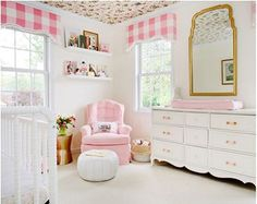 Pink and white baby girl nursery room with custom made DIY window toppers made from pink gingham pattern fabrics with bird theme wallpaper on the ceiling.