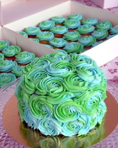 Peacock swirls.  www.sugardazecupcakes.com #wedding #cake  aww, these would be so cute for our engagement party!
