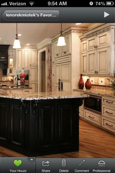 Love the dark and light kitchen cabinets