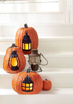 "Carefully painting around the ""panes"" of these old-school lamps creates the perfect flickering effect. Click through for the tutorial and more Halloween pumpkin decorating ideas and designs."