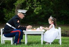 A real man is not afraid to play tea party with his child.